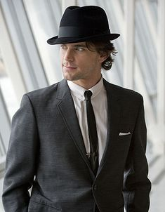 Neal Caffrey - Con man.  Grifter.  Devilishly stylish!  Yeah...