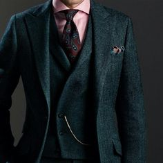 The vest detailing, the pocket watch, the wide spread collar...