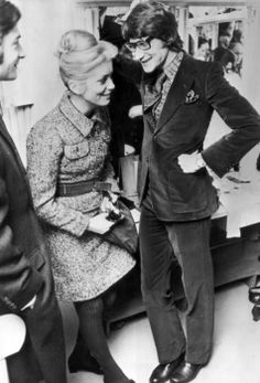 Deneuve with Saint Laurent backstage at his fashion show in Paris in January, 1968.