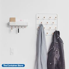 Imagine finding the right accessories instantly and getting out of the house in no time. Our over-the-door organizer by Umbra makes it happen, with a design that keeps everything sorted and easy to see. With 14 wooden-capped hooks, there's space for jewelry, scarves, wristlets, keys, lanyards and caps. Best of all, it can be installed quickly on a wall or door with included hardware.