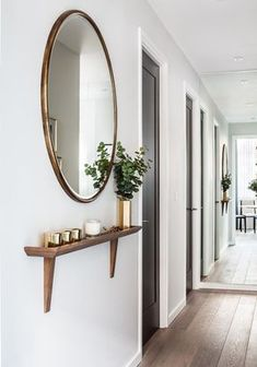 Looking 👀 to make a small entrance hallway look more spacious ? White walls, delicately placed picture /ornament and mirrors , mirrors ,… Entrance Hall Tables, Small Entrance Halls, Hallway Ideas Entrance Narrow, Small Entryways, Small Hallways, Small Hallway Table, Hallway Bench, Small Hallway Decorating, Decorating Ideas