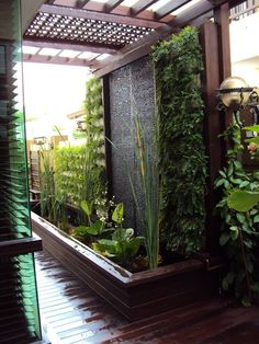 very zen - like the corrogated back - although i think mirror for where we need it. Water feature with vertical garden