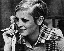 twiggy holding doll made by Mattel in her likeness