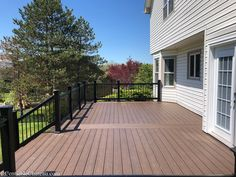Lowe's Composite Deck by Tropics is a beautiful low-maintenance product that is easy to install. See our beautiful new tropics deck and instructions how to install yours! Decking Area, Laying Decking, Big Deck, Cool Deck, Easy Deck, Timber Posts, Deck Plans, Composite Decking, Backyard