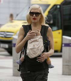 Doting: Stefani cradled her son's head protectively | Daily Mail | #babywearing #ergobabyeveryday #lovecarrieson