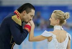 Maxim Trankov kisses the hand of Tatiana Volosozhar of Russia at the end of their performance during the Team Pairs Short Program at the Sochi 2014 Winter Olympics, February 6, 2014. REUTERS/Alexander Demianchuk