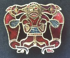 Two Wolves and a man - Odin? in gold with garnet inlay  6th Century CE. Sutton Hoo, England