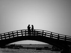 Lovers on the bridge. Lefkada. Greece