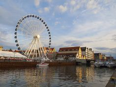 Motlawa river and ferris wheel in Gdansk, Poland. -- It is believed that the Motlawa Ferry in Gdansk has been crossing the river to the island of Ołowianka since 1687.