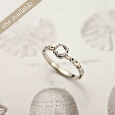 delicate diamond engagement ring. the article on this page is really good for helping the guy pick the perfect ring.
