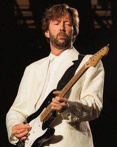 Eric Clapton - One of THEE BEST Guitarists EVER!  Right up there with, ah . . . with, ah . . .  Oh, never mind, he's in a class by himself!