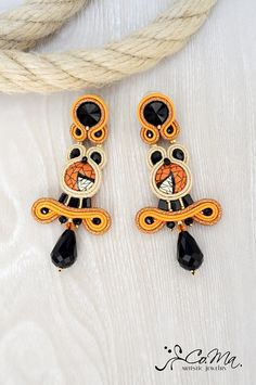 Earrings soutache with handpainted wooden cabochon, swarovski elements and semiprecious stone. Black, Orange and Ivory. Entirely hand-sewn in Italy with high quality materials. Co.Ma. Artistic Jewelry is an Italian brand, guarantee of high design and high quality.
