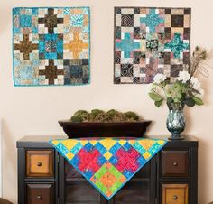 Put your best foot forward with the Crossroads Quilt Kit! You'll receive a pattern and fabric from Tonga Treats to sew this stunning design. Featuring a lush blend of colors and hand-stamped batiks, this quilt top is sure to enliven your decor.