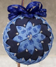 Customer supplied fabric and ribbon.  Handcrafted ornament.