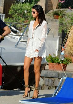 Selena Gomez boards Italian yacht in a lace mini dress and studded stilettos