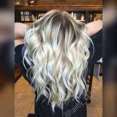 Dimensional bright blonde balayage highlights and stretched root look with beachy curls Hair by Rachel Fife @ Sara Fraraccio Salon in Akron, Ohio