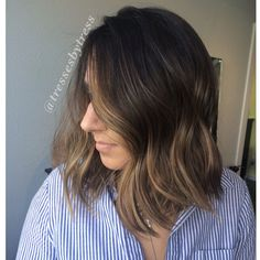 Dark brown ombre balayge with honey blonde and caramel blonde. Blunt textured lob