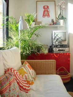 Raffia, metal locker, living plant, vintage fabrics and basket; very eclectic and international.