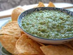 Tomatillo salsa verde, a delicious Mexican green salsa made with roasted tomatillos, chile peppers, lime juice, cilantro, and onion.