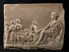 A relief found in Athens, 400 to 300 BC, showing worshipers approaching the goddess.