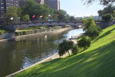 Sister Cities Bridge (with flags of Kansas Cities' sister cities) across Brush Creek in the Plaza, Kansas City, Missouri