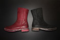 """The Nicola is an understated, mid-shin boot that's just about as cute and charming as your last major crush. Clean, sharp and casual like all The Modvogs, they have an inside zip and rubber injected leather sole that features brushed silver studs lining the sides. Built from washed leathers in Portugal, they have a barely there, 1"""" stacked leather heel. Look sharp."""