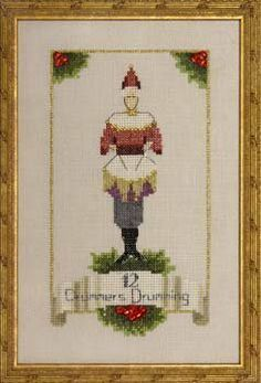 Twelve Drummers Drumming is the title of this cross stitch pattern from Nora Corbett's 12 Days of Christmas series.