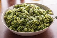 This easy pasta recipe has a pesto made of spinach, pine nuts, and Parmesan cheese that's tossed with fusilli pasta.