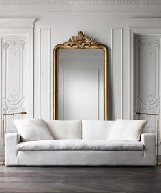 Oversized mirror behind sofa