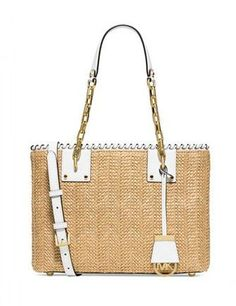 4a747fdaf6fd Elevate your classic style with this glamorous woven tote from MICHAEL  Michael Kors