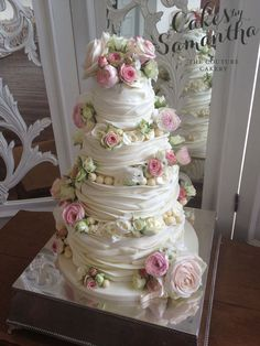 Jenny - 4 tier chocolate wrapped cake decorated with fresh flowers.