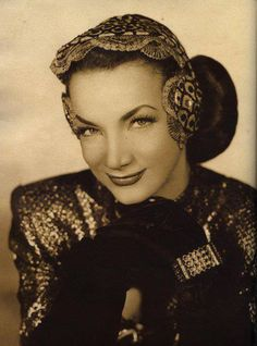 Carmen Miranda. This hat would look ridiculous on many.