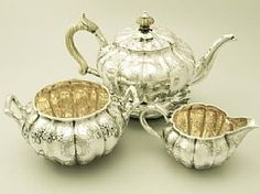 A fine and impressive antique George IV English sterling silver three piece tea service / set with matching teapot stand; part of our silver teaware collection  http://www.acsilver.co.uk/shop/pc/Sterling-Silver-Three-Piece-Tea-Service-with-Matching-Teapot-Stand-Antique-George-IV-96p3594.htm