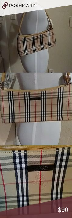 Burberry of London Blue label Excellent condition purse. No rips or tears. Pet and smoke free home. Not sure if it is inspired or the real deal. Price reflects this. Bags Totes