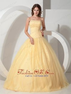 Custom Made Light Yellow Quinceanera Dress Strapless Beading  http://www.fashionos.com    Every girl dreams of being a princess. This one is a great choice for you. It has a strapless bodice with straight neckline, the bodice is full with beads and sequins all the way round to the open back. The A-line skirt is full and shapely with stunning crystals and sequins accented on the tulle overlay. The back of the dress has a lace-up closure that makes for easy off and on.