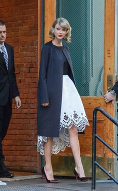Pin for Later: Taylor Swift: Professional Coat Collector  Now this is how to wear a coat over a fancy dress.