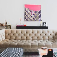 Totally in love with this #neutral tufted couch and #pink artwork  #instacurated → bit.ly/bandmanager for more! // via https://instagram.com/p/zsWv-hOa_S/