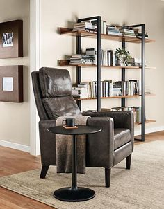 The Wynton leather recliner has a soft sink-in leather seat and a semi-attached back and head pillow that encourage lounging. Its clean silhouette and tall legs give it a light presence, offering you all the comfort of a recliner in a sleek look.