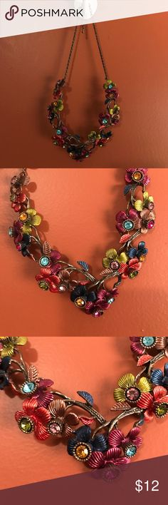Metal Multi-Color Flower Statement Necklace Beautiful statement necklace with jewel tone flowers. The flowers are a hard metal and lay flat on the chest. Center of each flower is a rhinestone. Adjustable clasp! So chic! Jewelry Necklaces