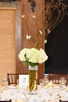 Half of the Centerpieces were tall cylinder vases with curly willow and white and green hydrangea. With dendrobium orchids attached to the branches.