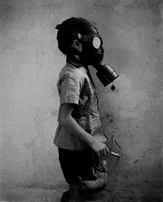 Kid with gasmask rather macabre but a possibility. Note the rat in the trap?