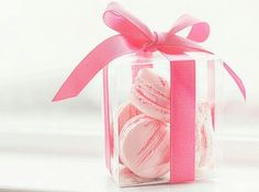 Gorgeous pink macaron in a transparent box