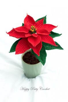 Crochet Poinsettia Flower Pattern by Happy Patty Crochet // A popular choice as decor and/or gift in Christmas time, and can be either placed in a small pot or in a larger vase. A perfect table or windowsill decoration.