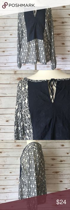 """Kate & Sam Navy & White Boho Chic Blouse Feminine boho chic soft navy and white blouse by Kate & Sam. • 26"""" long • 25"""" pit to pit • 19"""" shoulder to shoulder • In great condition   🚭 Smoke-free home 📬 Ships by next day 💲 Price negotiable  🔁 Open to trades Kate & Sam Tops Blouses"""