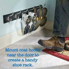Mount coat hooks near the door to create a handy shoe rack.