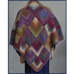 This lovely knit shawl has a crochet look, but is knit and has the soft drape of knitting. With Mochi Plus the colors change for you and there is no need to change colors of yarn.