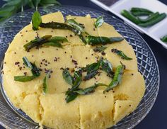 Instant Khaman Dhokla – a nutritious and irresistible Gujarati snack. Khaman Dhokla is prepared with gram flour, mixed with spices and steamed till its soft and fluffy.