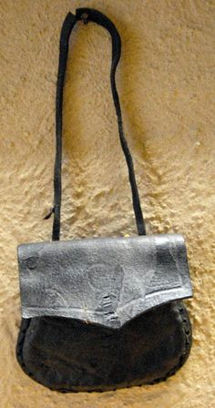 Medieval leather pouch with a small amount of tooling on flap; Novgorod Archaeological Museum.