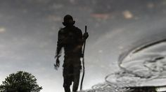 A statue of Mahatma Gandhi is reflected in a puddle of rain in Rio de Janeiro, Brazil (AFP Photo/Yasuyoshi Chiba)