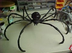 DIY spiders.....making a larger scale of this for outside of the house....maybe on the roof or trees